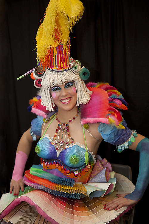 A photo of a woman wearing a very colorful costume and hat