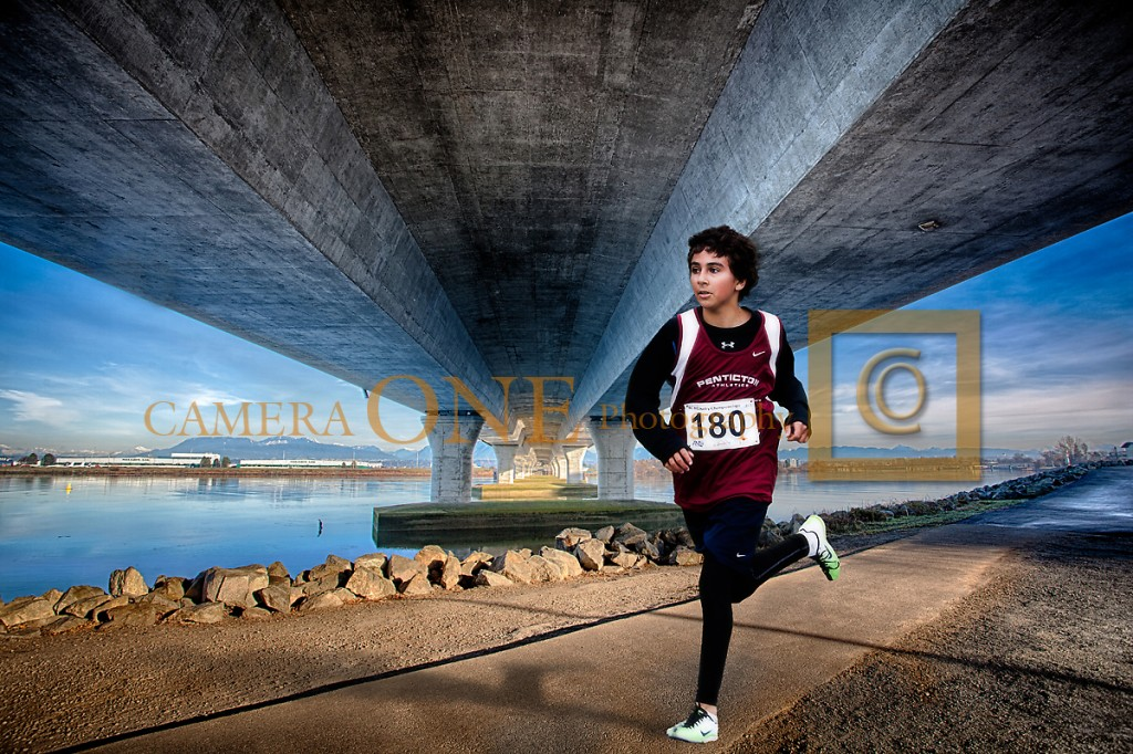 A photo of a young male runner who's wearing jersey number 180