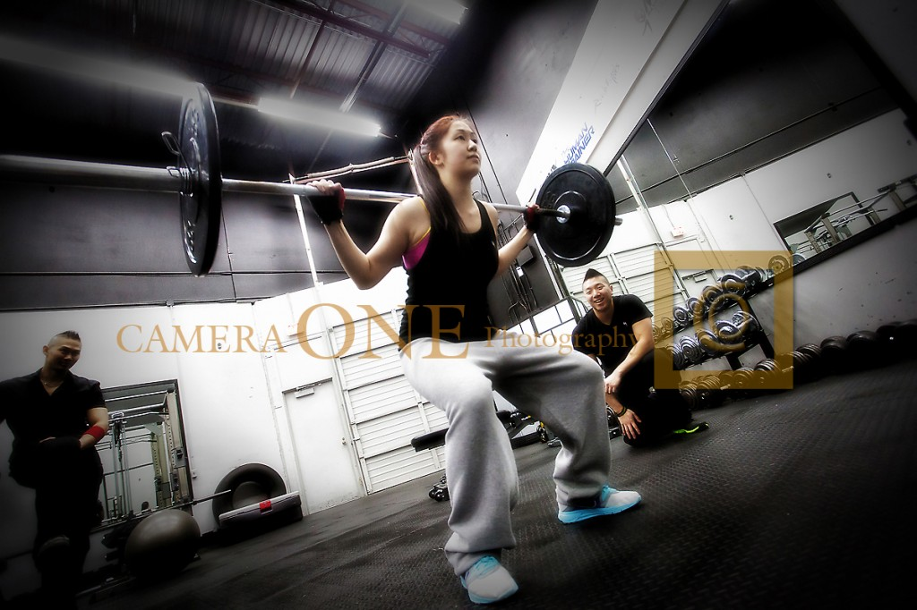 A photo of a woman lifting weights