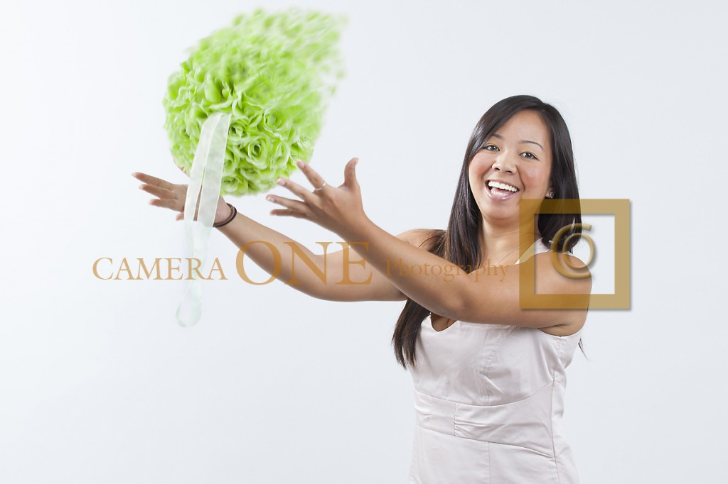 A photo of a woman catching a bouquet